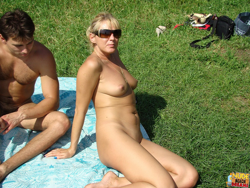 Nude sunbathers partying at the beach - Beach Swingers